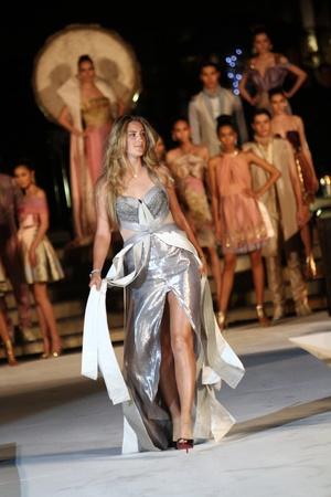 Hua Hin - December 28:Victoria Azarenka of Belarus walk in catwalk in concept Thai silk. Before tennis Match