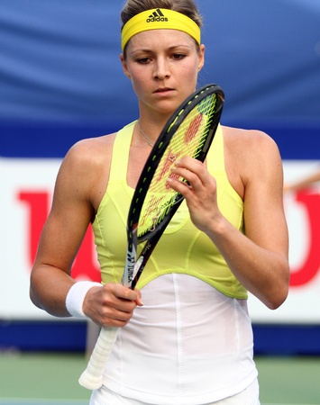 Pattaya, Thailand - FEB 3:Maria Kirilenko of Russia check racquet in tennis match PTT Pattaya Open 2013 at Dusit thani pattaya   on February 3, 2013 in Pattaya, Thailand.