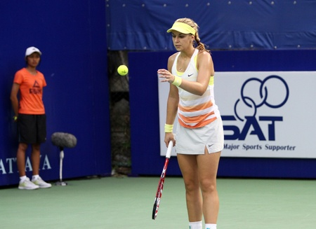 Pattaya, Thailand - FEB 3:Sabine Lisicki of Germany get a tennis ball in a PTT Pattaya Open 2013 at Dusit thani pattaya on   February 3, 2013 in Pattaya, Thailand. Stock Photo - 17863877