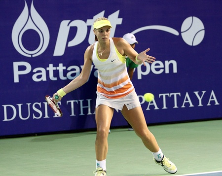 Pattaya, Thailand - FEB 3:Sabine Lisicki of Germany crushing a forehand in tennis match PTT Pattaya Open 2013 at Dusit thani   pattaya on February 3, 2013 in Pattaya, Thailand.