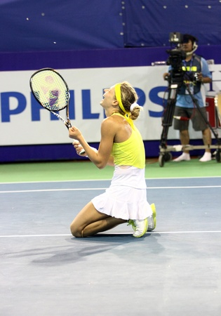 reacts: Pattaya, Thailand - FEB 3:Maria Kirilenko of Russia winer of PTT Pattaya Open single women championships reacts after final   match against Sabine Lisicki of Germany at Dusit thani pattaya on February 3, 2013 in Pattaya, Thailand. Editorial