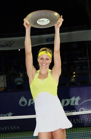 Pattaya, Thailand - FEB 3:Maria Kirilenko of Russia with the trophy after final match of PTT Pattaya Open 2013 against   Sabine Lisicki of Germany on February 3, 2013 in Pattaya, Thailand.