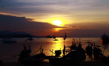 Nice landscape fishing boat with sunset at Koh samui, Thailand photo