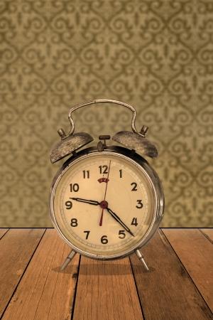 Retro clock on vintage wallpaper photo