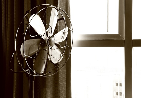 Old electric fan in sepia photo