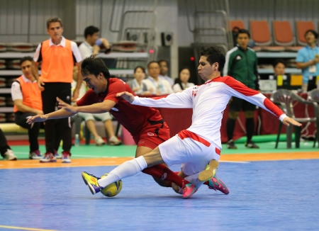 Incheon - July 4 JAVID Mahdi of Iran  W  and SORNWICHIAN Jirawat of Thailand fight for the ball during an Asian Indoor and Martial Arts Games at Songdo Global University on July 4, 2013 in Incheon, Korea