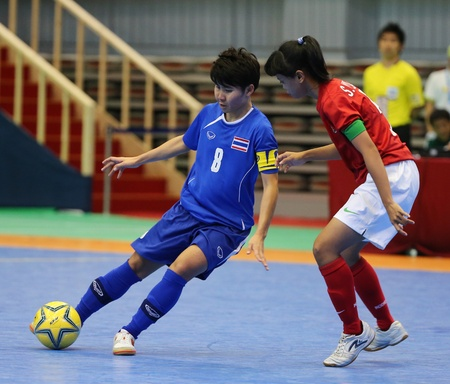 Incheon - July 5 SRIMANEE Orathai  8 of Thailand in action during futsal match vs  Indonesia in an 4th Asian Indoor and Martial Arts Games at Songdo Global University on July 5, 2013 in Incheon, Korea  Stock Photo - 20877604