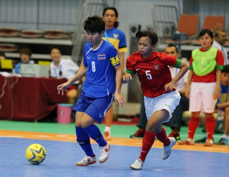 Incheon - July 5 SRIMANEE Orathai  8 of Thailand in action during futsal match vs  Indonesia in an 4th Asian Indoor and Martial Arts Games at Songdo Global University on July 5, 2013 in Incheon, Korea  Stock Photo - 20877605