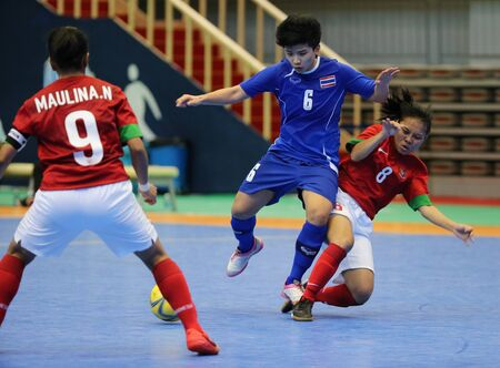Incheon - July 5 TUPSURI Jiraprapa  6 of Thailand in action during futsal match vs  Indonesia in an 4th Asian Indoor and Martial Arts Games at Songdo Global University on July 5, 2013 in Incheon, Korea  Stock Photo - 20877608