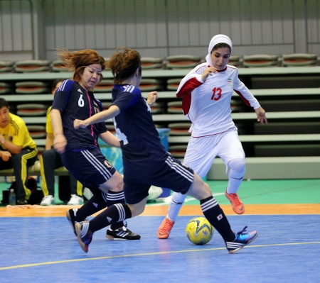 Incheon - July 5 ETEDADI Fatemeh  13 of Iran drives the ball during an 4th Asian Indoor and Martial Arts Games at Songdo Global University on July 5, 2013 in Incheon, Korea  Stock Photo - 20877618