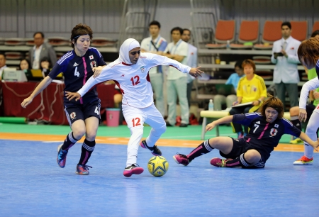 Incheon - July 5 ZAREI Fahimeh  12 of Iran drives the ball during an 4th Asian Indoor and Martial Arts Games at Songdo Global University on July 5, 2013 in Incheon, Korea  Stock Photo - 20877619