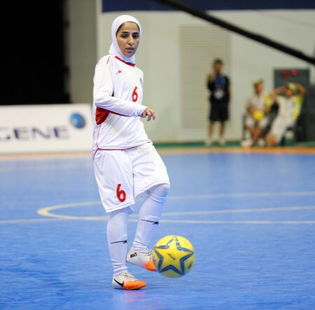 Incheon - July 5 GHOLAMI Nasimeh Sadat of Iran in action during futsal match vs  Japan in an Asian Indoor and Martial Arts Games at Songdo Global University on July 5, 2013 in Incheon, Korea  Stock Photo - 20877621