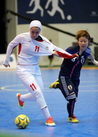 Incheon - July 5 ARDALLANI Niloofar of Iran  11 and KOIDE Natsumi of Japan fight for the ball during an Asian Indoor and Martial Arts Games at Songdo Global University on July 5, 2013 in Incheon, Korea  Stock Photo - 20877622