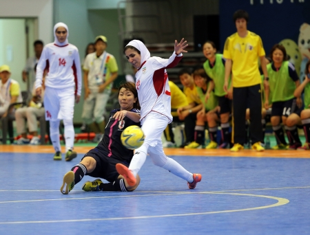 Incheon - July 5 NAKAJIMA Shiori of Japan  L  and ETEDADI Fatemeh of Iran fight for the ball during an Asian Indoor and Martial Arts Games at Songdo Global University on July 5, 2013 in Incheon, Korea  Stock Photo - 20877627