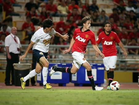 Bangkok - July 13 Adnan Januzaj of Man Utd  drives the ball during Singha   80th Anniversary Cup Manchester United vs Singha All Star at Rajamangala Stadium on July 13,2013 in   Bangkok, Thailand  Editorial