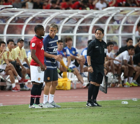 Bangkok - July 13 Patrice Evra  R  of Man Utd  waiting for substitute in the Singha   80th Anniversary Cup Manchester United vs Singha All Star at Rajamangala Stadium on July 13, 2013 in   Bangkok, Thailand