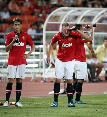 Bangkok - July 13 Phil Jones  R  of Man Utd  in action during Singha 80th Anniversary   Cup Manchester United vs Singha All Star at Rajamangala Stadium on July 13, 2013 in Bangkok,   Thailand