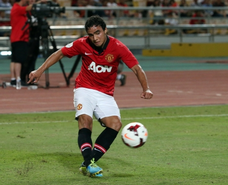 silva: Bangkok - July 13 Rafael Da Silva  R  of Man Utd  drives the ball during Singha   80th Anniversary Cup Manchester United vs Singha All Star at Rajamangala Stadium on July 13,2013 in   Bangkok, Thailand