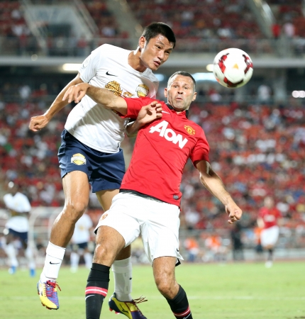 Bangkok - July 13 Ryan Giggs  R  of Man Utd  fight for the ball during Singha   80th Anniversary Cup Manchester United vs Singha All Star at Rajamangala Stadium on July 13,2013 in   Bangkok, Thailand