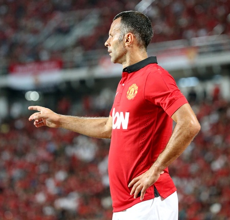 Bangkok - July 13 Ryan Giggs of Man Utd  in action during Singha 80th   Anniversary Cup Manchester United vs Singha All Star at Rajamangala Stadium on July 13,2013 in   Bangkok, Thailand