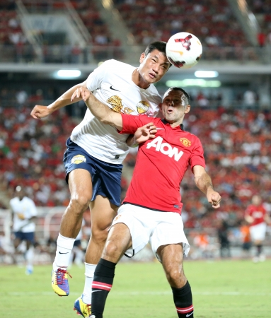 Bangkok - July 13 Ryan Giggs  R  of Man Utd  fight for the ball during Singha   80th Anniversary Cup Manchester United vs Singha All Star at Rajamangala Stadium on July 13,2013 in   Bangkok, Thailand  Editorial
