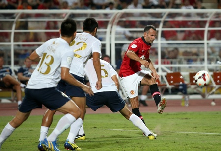 Bangkok - July 13 Ryan Giggs  R  of Man Utd  cross ball during Singha 80th   Anniversary Cup Manchester United vs Singha All Star at Rajamangala Stadium on July 13,2013 in   Bangkok, Thailand
