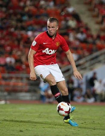 Bangkok - July 13 Tom Cleverley  R  of Man Utd  in action during Singha 80th Anniversary Cup Manchester United vs Singha All Star at Rajamangala Stadium on July 13,2013 in Bangkok, Thailand