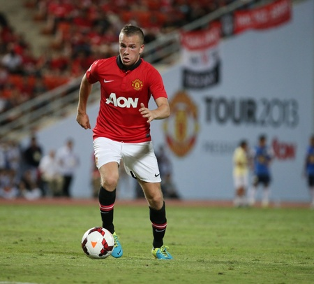 Bangkok - July 13 Tom Cleverley  R  of Man Utd  in action during Singha 80th Anniversary Cup Manchester United vs Singha All Star at Rajamangala Stadium on July 13,2013 in Bangkok, Thailand  Editorial