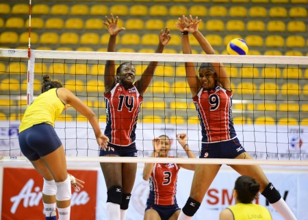 perez: Nakhon Ratchasima, Thailand - July 26 Yokaty Perez Flores  14 and Angelica Maria Hinojosa Diaz  9 of Dominican Republic paticipates in a FIVB Volleyball Girls' U18 World Championship at Chatchai Hall on July 26, 2013 in Nakhon Ratchasima, Thailand