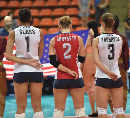 Bangkok, Thailand - August 17 Glass 1 , Banwarth 2  and Thompson 3  of USA participates in a Volleyball World Grand Prix 2014 at Indoor Stadium Huamark on August 17, 2014 in Bangkok, Thailand