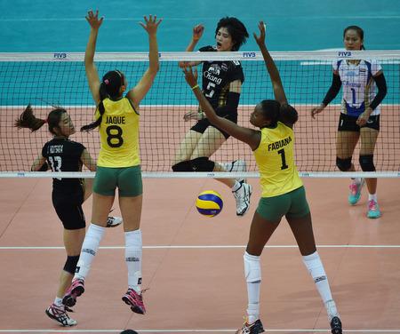 Bangkok, Thailand - August 17 Pleumjit Thinkaow of Thailand participates in a Volleyball World Grand Prix 2014 at Indoor Stadium Huamark on August 17, 2014 in Bangkok, Thailand