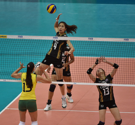 Bangkok, Thailand - August 17 Thatdao Nuekjang  4 of Thailand participates in a Volleyball World Grand Prix 2014 at Indoor Stadium Huamark on August 17, 2014 in Bangkok, Thailand