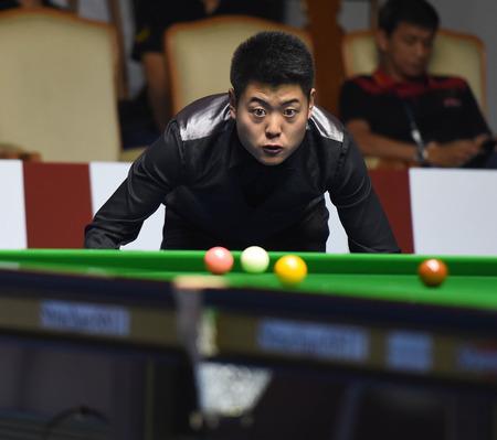 Bangkok, Thailand - SEP 4:Liang Wenbo of China in action during Sangsom Six-red World Championship 2014 at Montien Riverside Hotel on September 4, 2014 in Bangkok, Thailand.