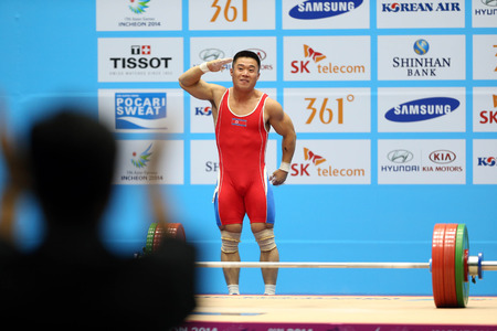 incheon: INCHEON - SEP 21:KIM Unguk of DPR Korea participates in  2014 Incheon Asian Games at Moonlight Festival Garden Weightlifting Venue on September 21, 2014 in Incheon, South Korea. Editorial