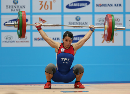 incheon: INCHEON - SEP 22:KUO Hsing Chun of Chinese Taipei participates in 2014 Incheon Asian Games at Moonlight Festival Garden Weightlifting Venue on September 22, 2014 in Incheon, South Korea. Editorial