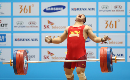 INCHEON - SEP 25:LIU Hao of China participates in 2014 Incheon Asian Games at Moonlight Festival Garden Weightlifting Venue on September 25, 2014 in Incheon, South Korea.