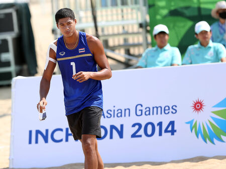 incheon: INCHEON - SEP 22:Sittichai SANGKHACHOT of Thailand participates in 2014 Incheon Asian Games at Songdo Global Uni. Beach Volleyball on September 22, 2014 in Incheon, South Korea.