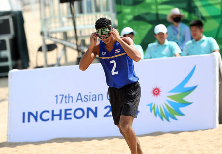 incheon: INCHEON - SEP 22:Prathip SUKTO of Thailand participates in 2014 Incheon Asian Games at Songdo Global Uni. Beach Volleyball on September 22, 2014 in Incheon, South Korea. Editorial