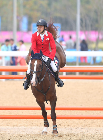 takashi: INCHEON - SEP 28:UTSUNOMIYA Takashi of Japan  in action during the 2014 Incheon Asian Games at Dream Park Equestrian Venue on September 28, 2014 in Incheon, South Korea.