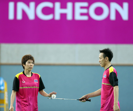 incheon: INCHEON - SEP 25:Saralee THOUNGTHONGKAM(L) and Sudket PRAPAKAMOL of Thailand participates in 2014 Incheon Asian Games at Gyeyang Gymnasium on September 25, 2014 in Incheon, South Korea.