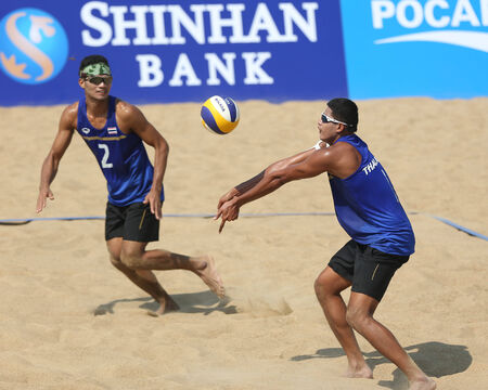 incheon: INCHEON - SEP 22: Prathip SUKTO(L) and Sittichai SANGKHACHOT(R) of Thailand participates in 2014 Incheon Asian Games at Songdo Global Uni. Beach Volleyball on September 22, 2014 in Incheon, South Korea. Editorial