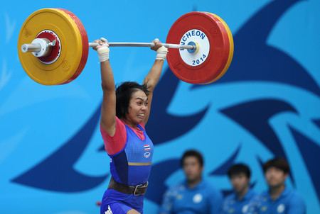 incheon: INCHEON - SEP 21:Kittima SUTANAN of Thailand participates in 2014 Incheon Asian Games at Moonlight Festival Garden Weightlifting Venue on September 21, 2014 in Incheon, South Korea.