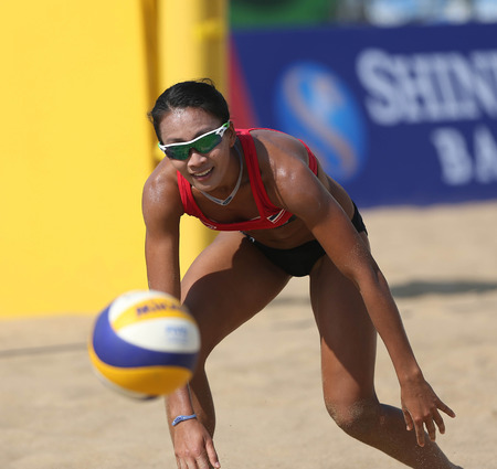 incheon: INCHEON - SEP 22:Tanarattha UDOMCHAVEE of Thailand participates in 2014 Incheon Asian Games at Songdo Global University Beach Volleyball Venue on September 22, 2014 in Incheon, South Korea.