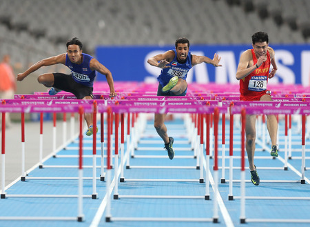 INCHEON - SEP 30:XIE Wenjun of China in action during the 2014 Incheon Asian Games at Incheon Asiad Main Stadium on September 30, 2014 in Incheon, South Korea. Stock Photo - 32585073