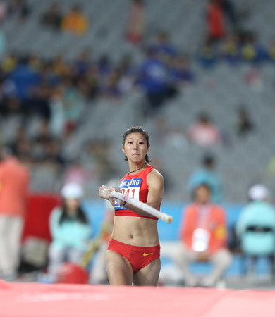 INCHEON - SEP 30:XU Huiqin of China in action during the 2014 Incheon Asian Games at Incheon Asiad Main Stadium on September 30, 2014 in Incheon, South Korea.