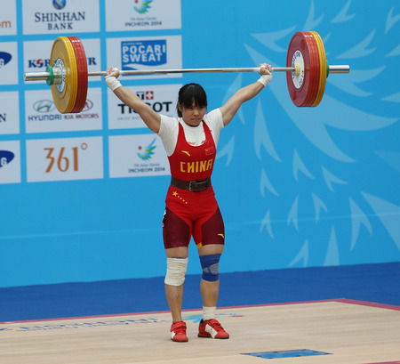 INCHEON - SEP 21:ZHANG Wanqiong of China participates in 2014 Incheon Asian Games at Moonlight Festival Garden Weightlifting Venue on September 21, 2014 in Incheon, South Korea.