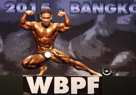 mach: Bangkok - November 27:Pham Van Mach of Vietnam in action during WBPF World Bodybuilding and Physique Sport Championships 2015 at MCC Hall The Mall Bangkapi on November 27, 2015 in Bangkok, Thailand.
