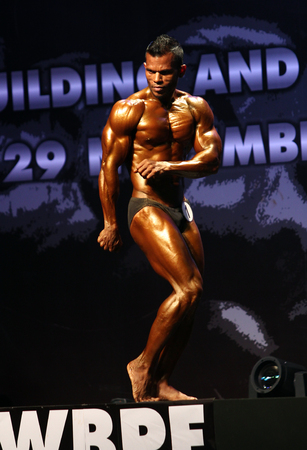 Bangkok - November 27:Ibrahim Didi Shaheen of Maldives in action during WBPF World Bodybuilding and Physique Sport Championships 2015 at MCC Hall The Mall Bangkapi on November 27, 2015 in Bangkok, Thailand. 報道画像