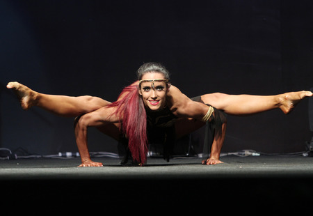 physique: Bangkok - November 27:Zsofia Krassalkovics of Hungary in action during WBPF World Bodybuilding and Physique Sport Championships 2015 at MCC Hall The Mall Bangkapi on November 27, 2015 in Bangkok, Thailand. Editorial