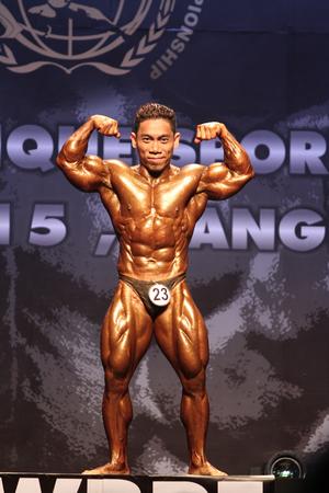 Bangkok - November 27:Pham Van Mach of Vietnam in action during WBPF World Bodybuilding and Physique Sport Championships 2015 at MCC Hall The Mall Bangkapi on November 27, 2015 in Bangkok, Thailand.